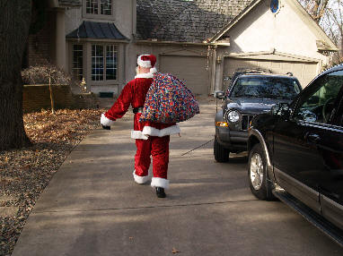 The longer the Minnesota driveway, the more Santa Joe appreciates a warm winter.
